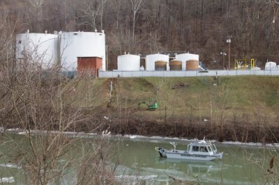 An environmental enforcement boat patrols in front of the chemical spill at Freedom Industries.