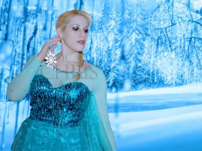 "Elsa Littlepage, professional cosplayer, as ""Elsa"" from Disney's ""Frozen""... Be nice, or she will send more snow and ice your way"