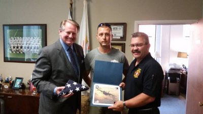 Huntington Firefighter Donates Combat Flag