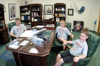 "The McCall kids take ""big daddy's"" chair at the office"