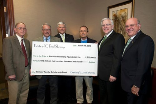 James D. Thornburg, Bill Shewey, Dr. Ron Area, Bob Shewey, Marshall President Stephen J. Kopp and Gary White pose for a photo around an oversized check for $1.2 million presented to the Marshall Foundation