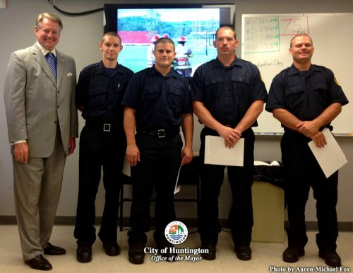 Mayor Steve Williams and Fire Chief Carl Eastham congratulate the newest class  graduates from the Tristate Fire Academy . Christopher Coleman, Mark Graves, Jason Boggs, and Robert Shepard were  sworn in as Probationary Firefighters 6 weeks ago.