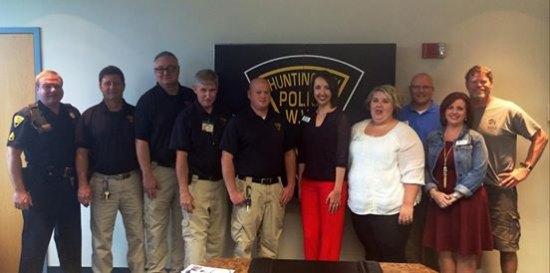 Huntington Police Team with Habitat's Brush of Kindness