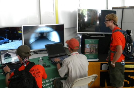 Scouts try their hand at navigating the virtual coal mine developed by Marshall University's Center for Environmental, Geotechnical and Applied Sciences for use in mine emergency response training.