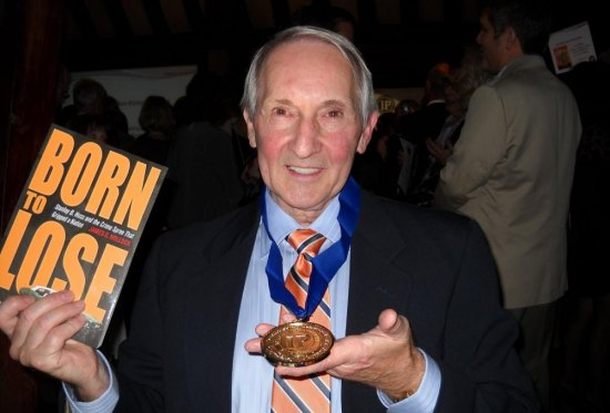 Jim Hollock smiles after receiving the gold medal for true crime by the 2012 Independent Publisher Book Awards for his book Born To Lose: Stanley B. Hoss and the Crime Spree That Gripped a Nation.