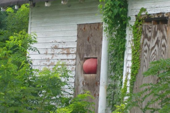 A basketball stuck in window of abandoned house on Monroe Avenue. Mayor Steve Williams announced a new River to Rail initiative for the West End of Huntington