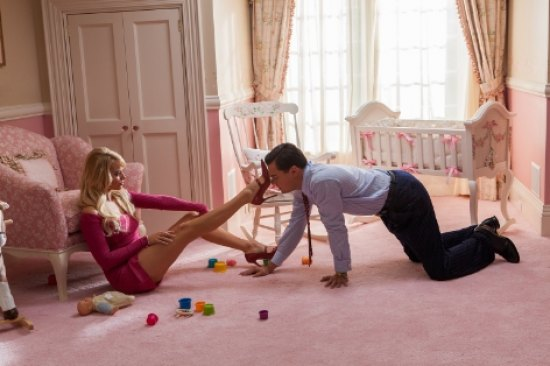 Left to right: Margot Robbie is Naomi Lapaglia and Leonardo DiCaprio is Jordan Belfort in THE WOLF OF WALL STREET, from Paramount Pictures and Red Granite Pictures.