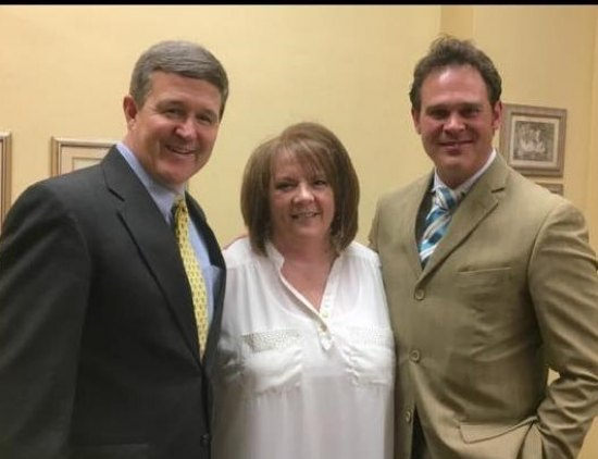 West Virginia Secretary of State Mac Warner, left, and Lee Dean, right, one of his field representatives, pay a visit to Cabell County Clerk Karen Cole prior to her death in August 2017.