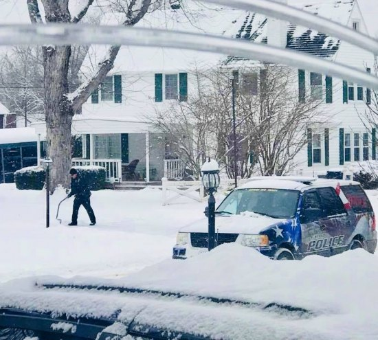 Ashland officer clear snow at elderderly woman's house