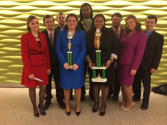 Members of the Thundering Word, Marshall University's speech and debate team, pose with their trophies after a solid third-place finish last weekend in the Tower Invitational at Eastern Michigan University.