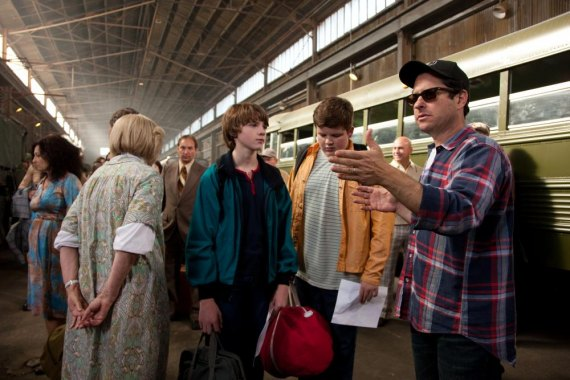 Photo credit: François Duhamel Center left to right: Joel Courtney (as Joe Lamb) and Riley Griffiths (as Charles) discuss a scene with director/writer/producer J.J. Abrams on the set of SUPER 8, from Paramount Pictures. © 2011 Paramount Pictures. All Righ