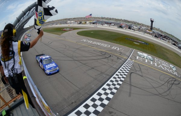 James Buescher, driver of the #31 Motomaster Eliminator Chevrolet, crosses the finish line to win the NASCAR Camping World Truck Series Fan Appreciation 200 presented by New Holland at the Iowa Speedway on September 8, 2013 in Newton, Iowa.