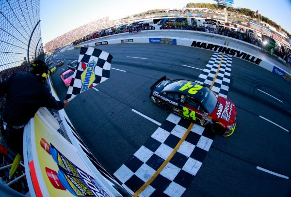 Jeff Gordon, driver of the #24 Drive To End Hunger Chevrolet, crosses the finish to win the NASCAR Sprint Cup Goody's Headache Relief Shot 500 Powered By Kroger at Martinsville Speedway on October 27, 2013 in Martinsville, Virginia.