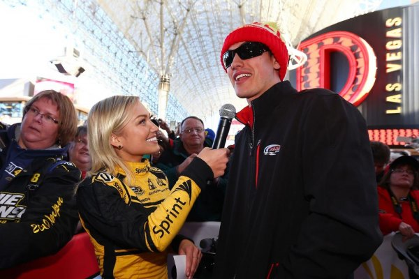 Miss Sprint Cup Brooke Werner interviews Sprint Cup Series driver Joey Logano at a fanfest hosted by Las Vegas Motor Speedway on the Third Street Stage at the Fremont Street Experience on December 4, 2013 in Las Vegas, Nevada.