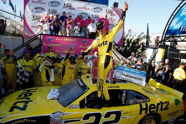 Joey Logano, driver of the #22 Hertz Ford, celebrates in Victory Lane after winning the NASCAR Nationwide Series 5-Hour Energy 200 Benefiting Living Beyond Breast Cancer at Dover International Speedway on September 28, 2013 in Dover, Delaware.