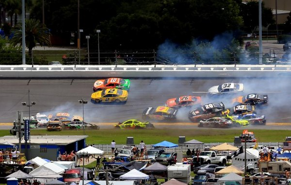 DAYTONA BEACH, FL - JULY 06: A large incident occurs in turn three during the NASCAR Sprint Cup Series Coke Zero 400 at Daytona International Speedway on July 6, 2014 in Daytona Beach, Florida.