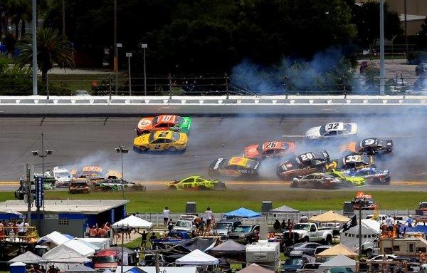 DAYTONA BEACH, FL - JULY 06: A large incident occurs in turn three during the NASCAR Sprint Cup Series Coke Zero 400 at Daytona International Speedway on July 6, 2014 in Daytona Beach, Florida.
