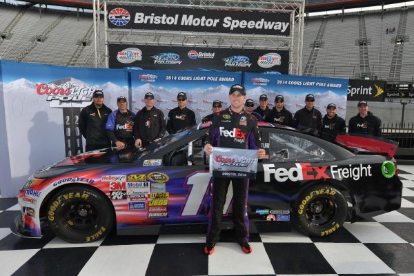 Denny Hamlin, driver of the #11 FedEx Freight Toyota, celebrates winning the pole position after qualifying for the NASCAR Sprint Cup Series Food City 500 at Bristol Motor Speedway on March 14, 2014 in Bristol, Tennessee.
