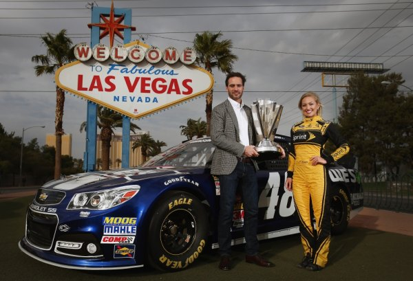 NASCAR Sprint Cup Champion Jimmie Johnson, and Miss Sprint Cup Brooke Werner pose for a photo at the 'Welcome to Fabulous Las Vegas' sign on in Las Vegas, Nevada. Johnson is in Las Vegas for a week of 2013 NASCAR Sprint Cup Championship activities.