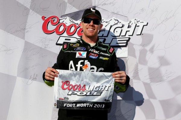 Carl Edwards, driver of the #99 Aflac Ford, poses with the Coors Light Pole Award after qualifying for the pole for the NASCAR Sprint Cup Series AAA Texas 500 at Texas Motor Speedway on November 1, 2013 in Fort Worth, Texas.