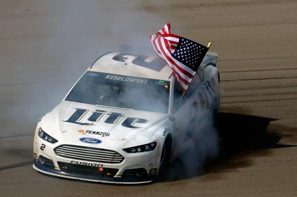 Brad Keselowski, driver of the #2 Miller Lite Ford, celebrates with a burnout after winning the NASCAR Sprint Cup Series Kobalt 400 at Las Vegas Motor Speedway on March 9, 2014 in Las Vegas, Nevada.