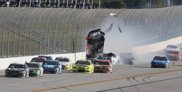 Austin Dillon, driver of the #14  Chevrolet, and Casey Mears, driver of the #13  Ford, are involved in an incident during the NASCAR Sprint Cup Series Camping World RV Sales 500 at Talladega Superspeedway on October 20, 2013 in Talladega, Alabama.
