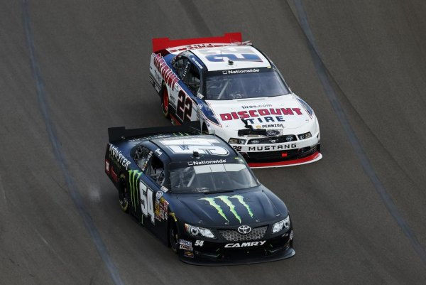 Kyle Busch, driver of the #54 Monster Energy Toyota, leads Brad Keselowski, driver of the #22 Discount Tire Ford, during the NASCAR Nationwide Series Blue Jeans Go Green 200 at Phoenix International Raceway on March 1, 2014 in Avondale, Arizona.