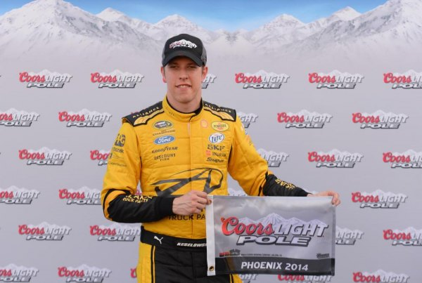 Brad Keselowski, driver of the #22 Shell-Pennzoil Ford, celebrates setting the pole position in qualifying for the NASCAR Sprint Cup Series The Profit on CNBC 500 at Phoenix International Raceway on February 28, 2014 in Avondale, Arizona.