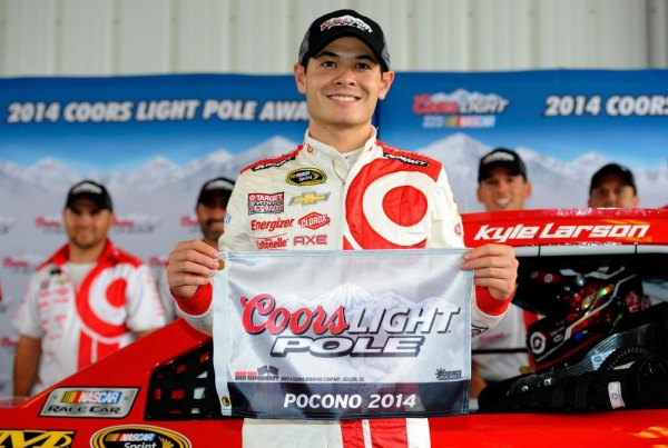 Kyle Larson, driver of the #42 Target Chevrolet, poses with the Coors Light Pole Award after qualifying for the NASCAR Sprint Cup Series GoBowling.com 400 at Pocono Raceway on August 1, 2014 in Long Pond, Pennsylvania.